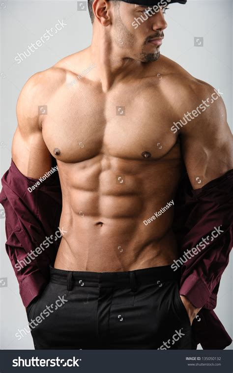 Male Fitness Model Flexing Abs With Button Shirt Half Off
