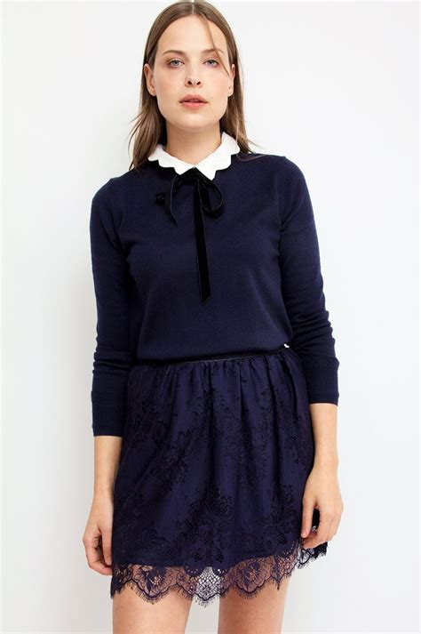 Seductive lace creates a dramatic finish on this navy